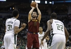 Cleveland Cavaliers' Kevin Love shoots during the first half of a game against the Milwaukee Bucks Tuesday, Dec. 19, 2017, in Milwaukee.