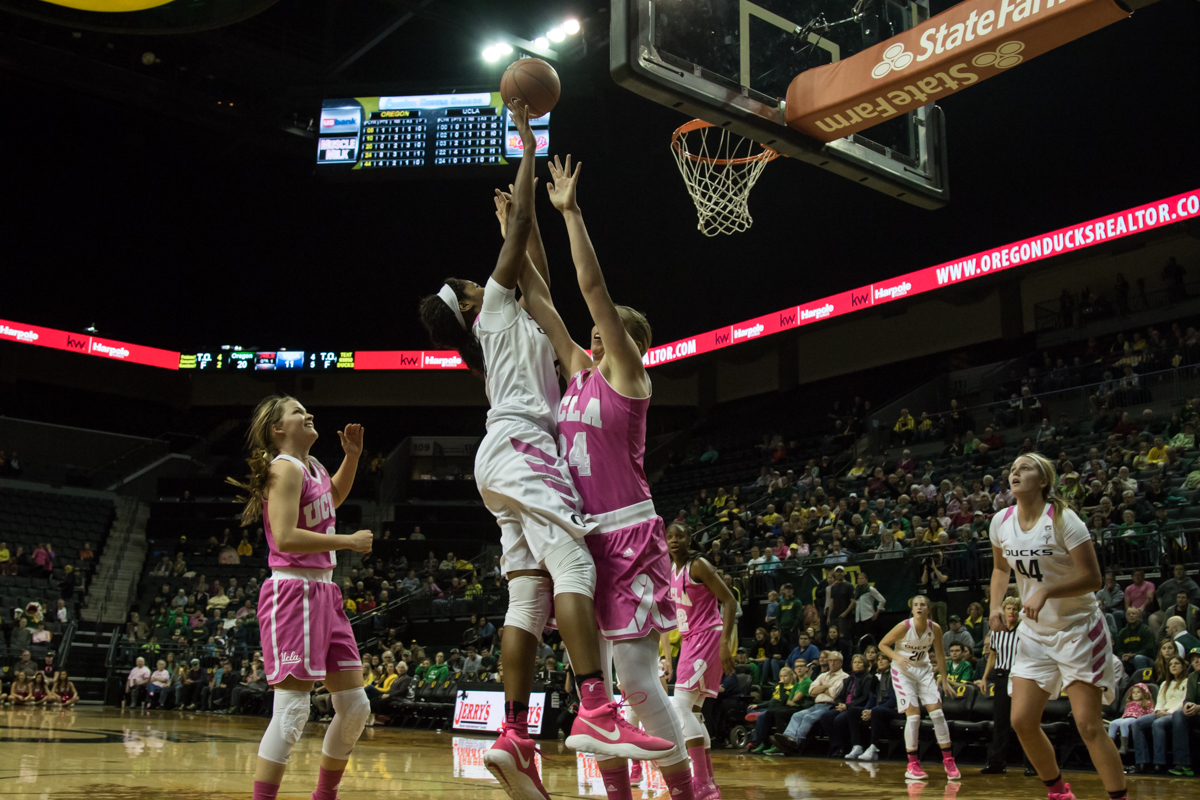 Oregon Ducks forward Ruthy Hebard (#24) shoots over UCLA Bruins forward Paulina Hersler (#24). The Oregon Ducks defeated the No. 15 UCLA Bruins 84-75 Friday evening at Matthew Knight Arena in Eugene, Oregon.  Photo by Austin Hicks, Oregon News Lab