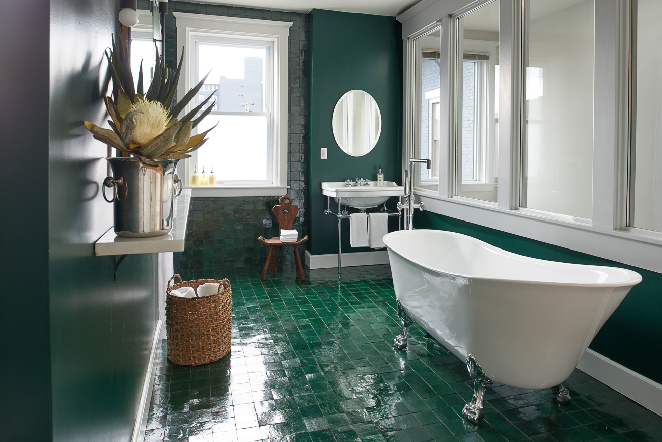 Emerald green tile hand-laid by Tim Gray immediately draws the eye through tall windows surrounding the bathroom. As you step into the room to admire the verdant wonder before you, an ivory clawfoot tub greets you. Somehow, without even showering, you feel cleansed. / Image: Brian Rineair // Published: 10.30.19