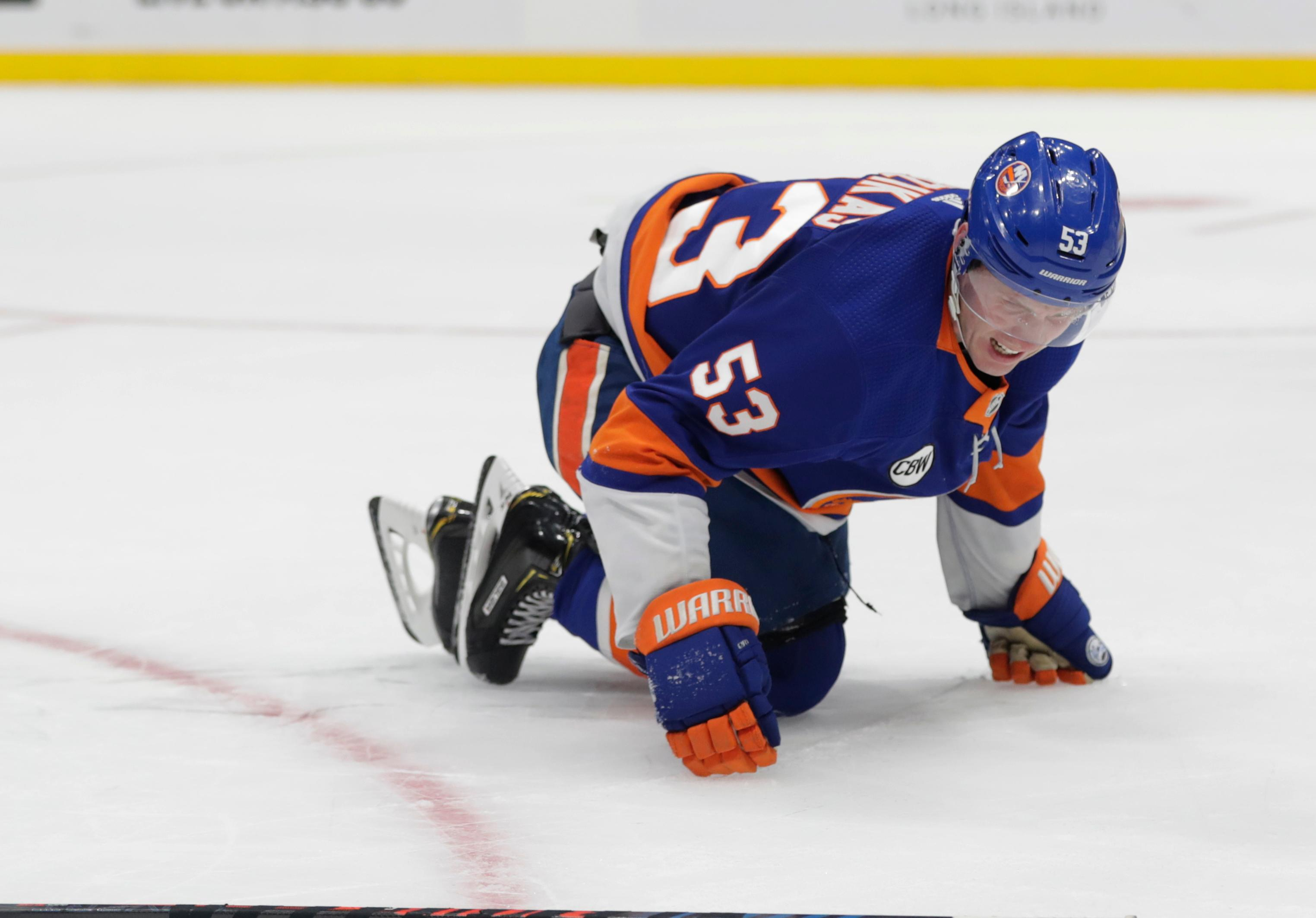 New York Islanders' Casey Cizikas (53) reacts after being hurt during the first period of an NHL hockey game against the Carolina Hurricanes Tuesday, Jan. 8, 2019, in New York. (AP Photo/Frank Franklin II)