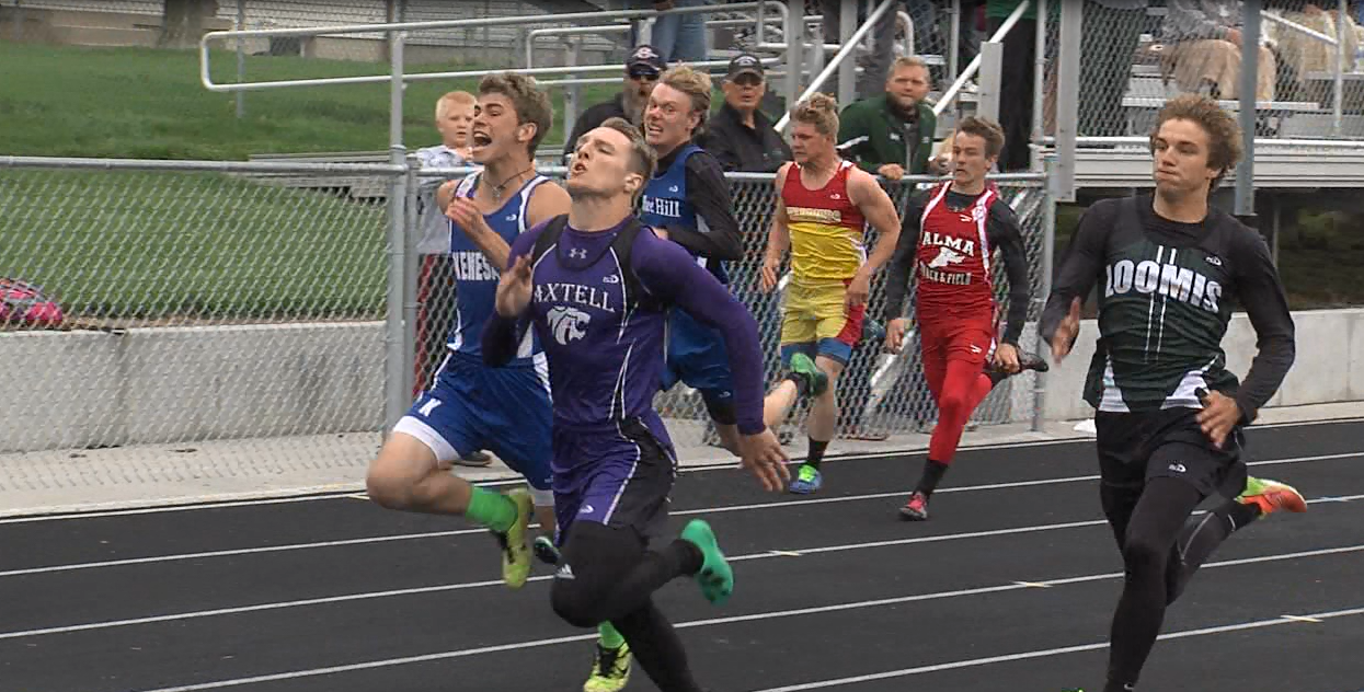 Axtell's Braiden Gomez (second from left) stays ahead of the field in the boys 100 M dash at the D8 district meet in Kenesaw on May 10, 2017 (NTV News)