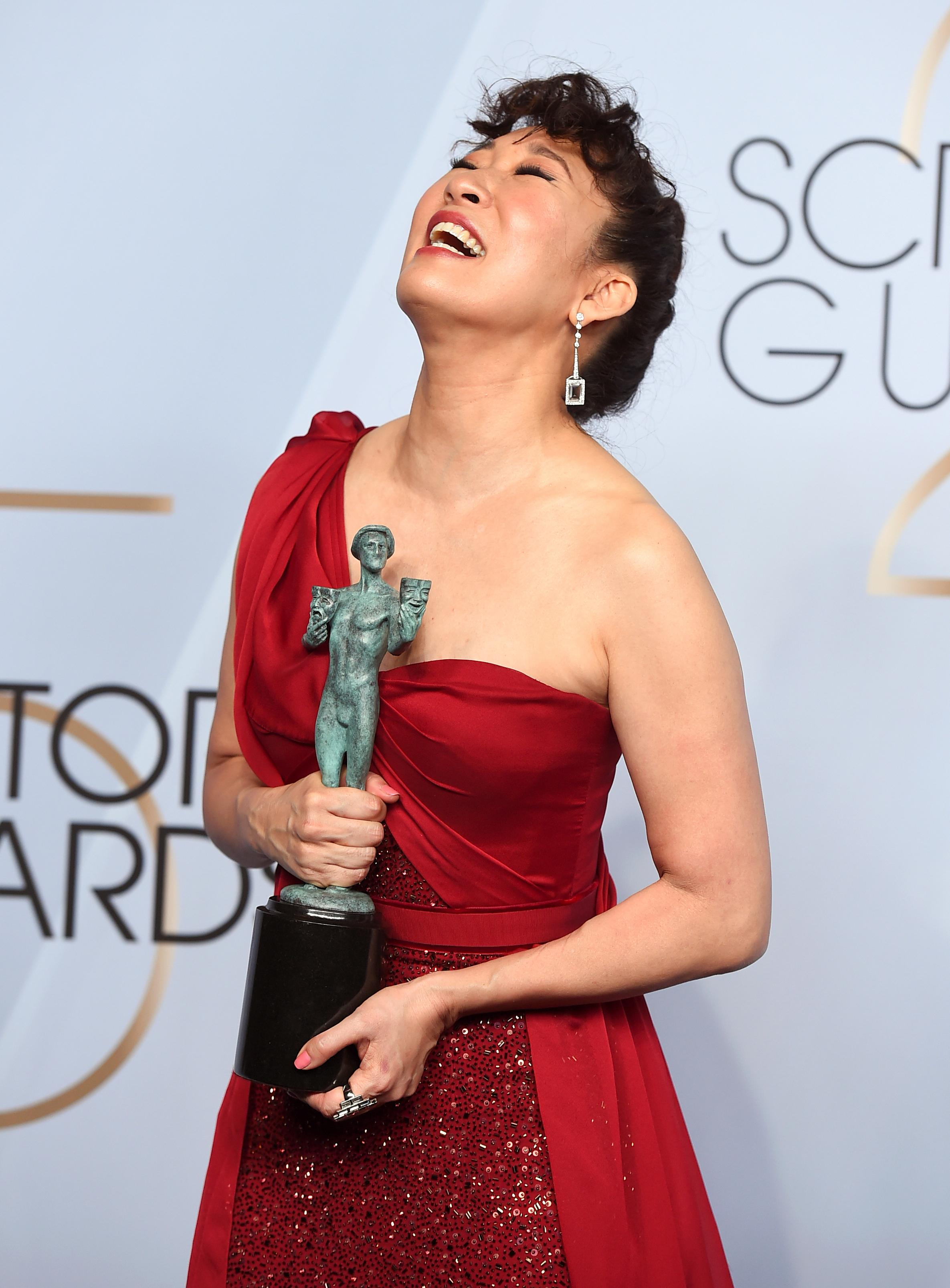 "Sandra Oh poses with the award for outstanding performance by a female actor in a drama series for ""Killing Eve"" in the press room at the 25th annual Screen Actors Guild Awards at the Shrine Auditorium & Expo Hall on Sunday, Jan. 27, 2019, in Los Angeles. (Photo by Jordan Strauss/Invision/AP)"