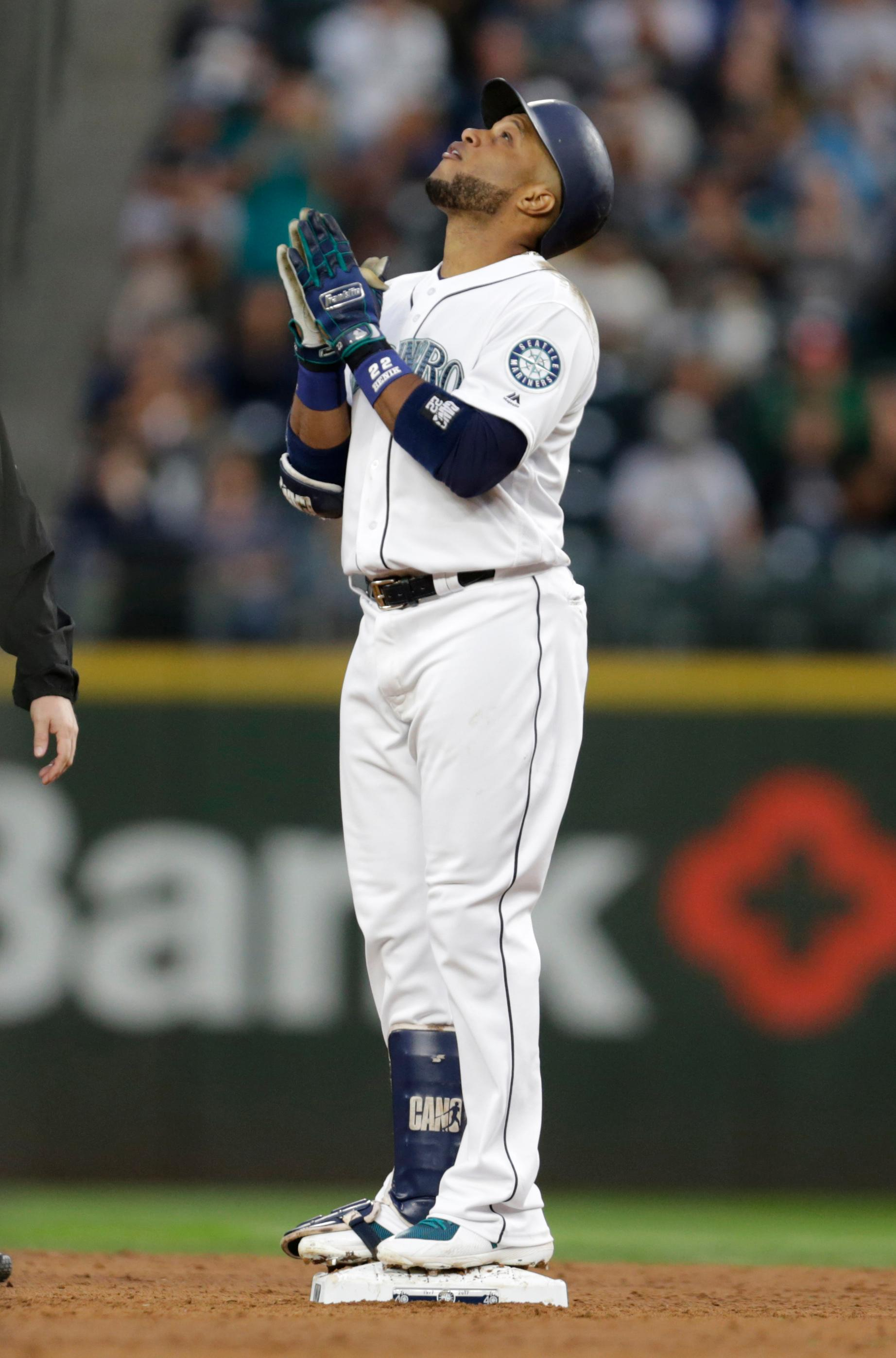Seattle Mariners' Robinson Cano reacts while standing on second base after hitting an RBI double against the Los Angeles Angels during the third inning of a baseball game Saturday, Sept. 9, 2017, in Seattle. (AP Photo/John Froschauer)