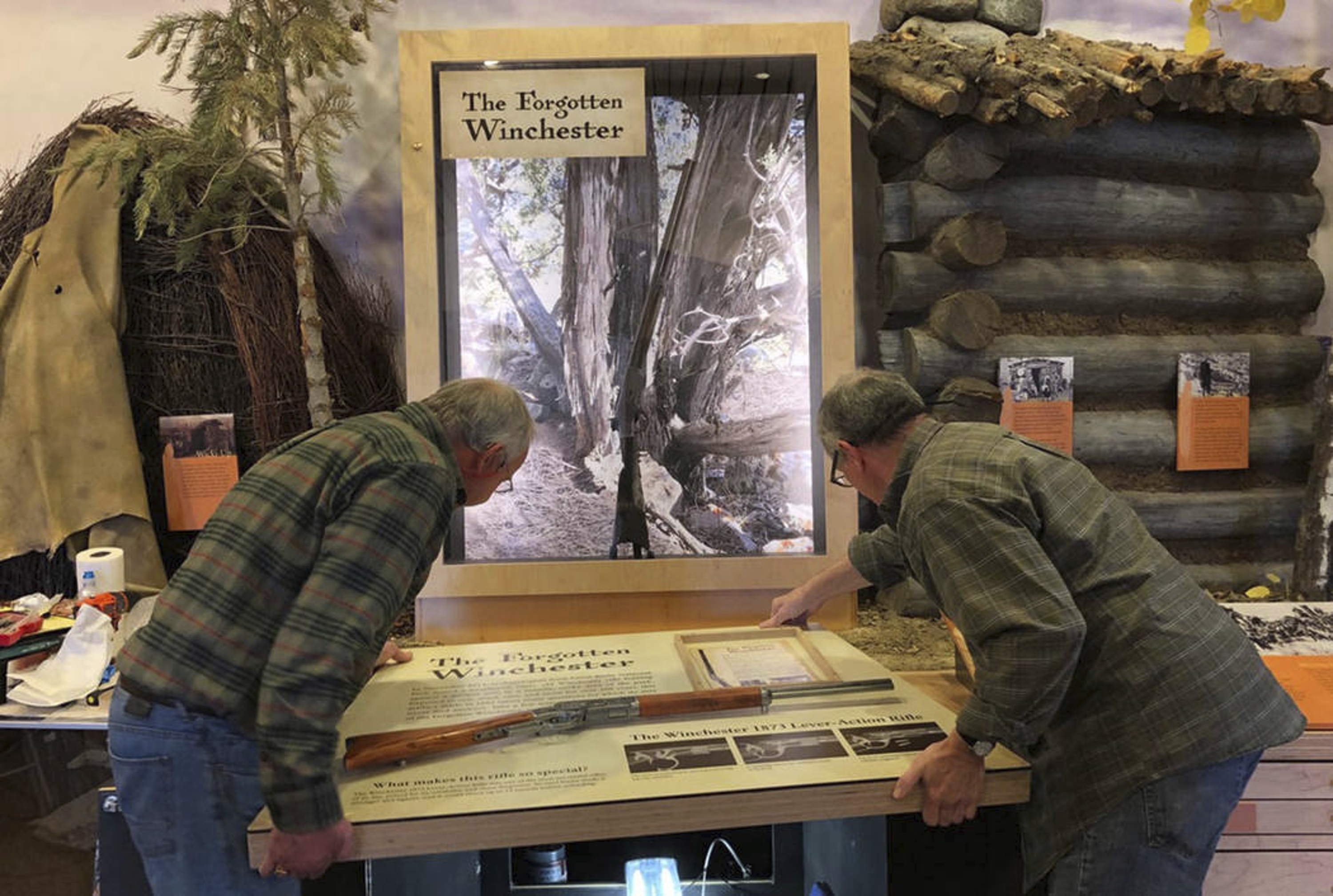"In this April 2019 photo workers for the design company DiVittorio and Associations help install the new exhibit at the visitor center at Great Basin National Park in Baker, Nev. for the ""Forgotten Winchester,"" an 1882 rifle that was discovered leaning against a tree in 2014. (National Park Service via AP)"