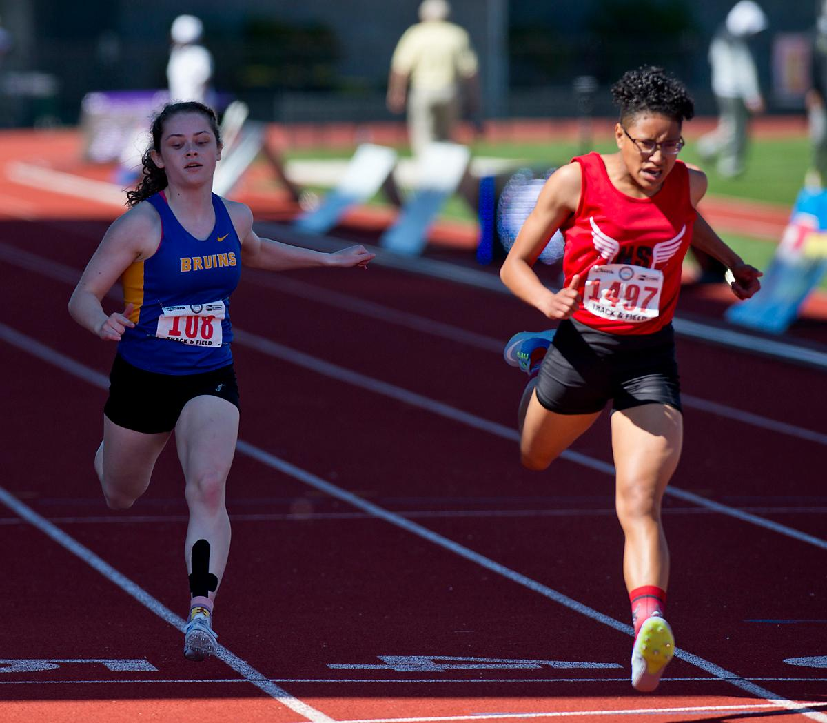Rebekah Miller from North Salem wins the 6A Girls 200 meter Dash with a time of 24.58 at the OSAA Championship at Hayward Field on Saturday. Photo by Dan Morrison, Oregon News Lab