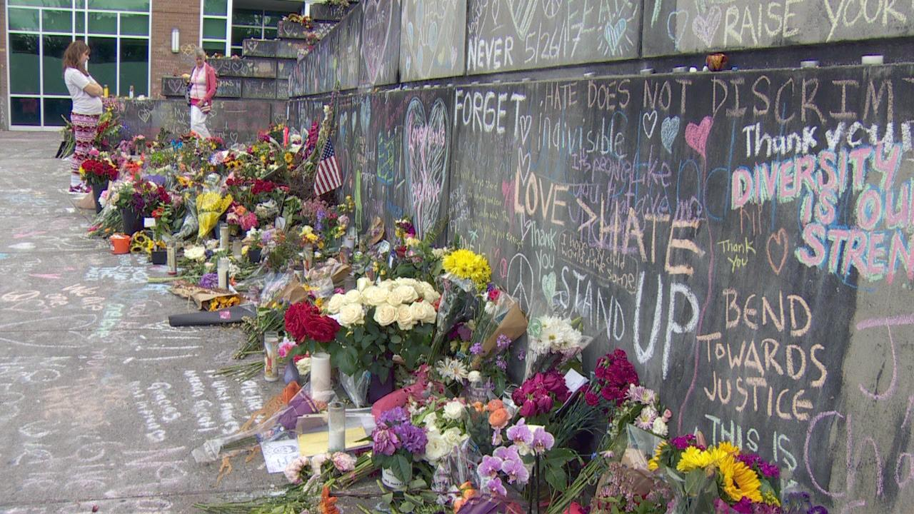 Flowers line the wall at the Hollywood Transit Center and messages of hope, of love and of tribute are scrawled upon it in honor of the three men who put themselves in danger to stand up against hate. Two of those men made the ultimate sacrifice. (KATU Photo)