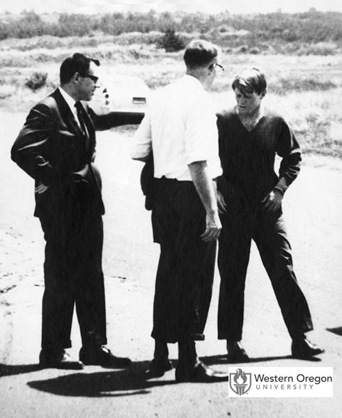 Senator Robert F. Kennedy talks with Oregon State Treasurer Robert W. Straub and his assistant Ken Johnson while visiting the Oregon coastline near Fort Stevens State Park. The photo was taken during Kennedy's visit before the 1968 Oregon primary election shortly before his assassination. (Western Oregon University Archives - Robert W. Straub Collection/Used with permission)