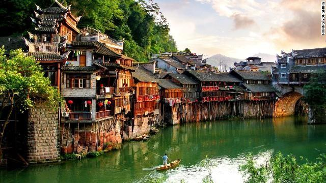 "Every year, armies of young backpackers flock to the ancient town of Fenghuang (which literally means ""Phoenix"") for its rich Miao and Tujia ethnic culture."
