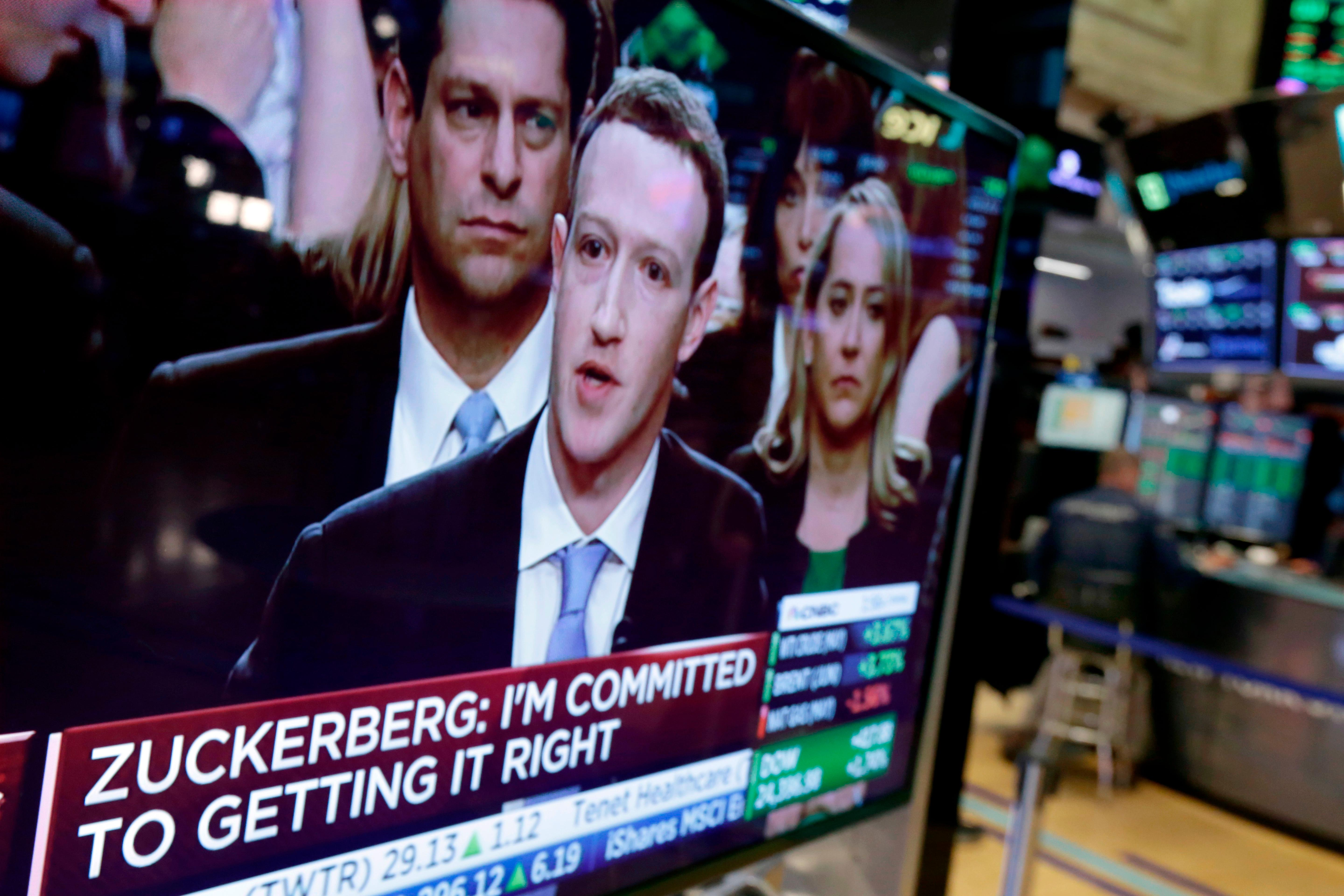 FILE - In this April 10, 2018 file photo, Facebook CEO Mark Zuckerberg appears on a television screen on the floor of the New York Stock Exchange as he testifies in the Senate in Washington.  Shares in the social media giant are trading around $185 early Friday, May 11, returning to the levels last seen eight weeks ago, when news broke that the company failed to prevent major privacy breaches during the run-up to the 2016 presidential election in the U.S. (AP Photo/Richard Drew, File)