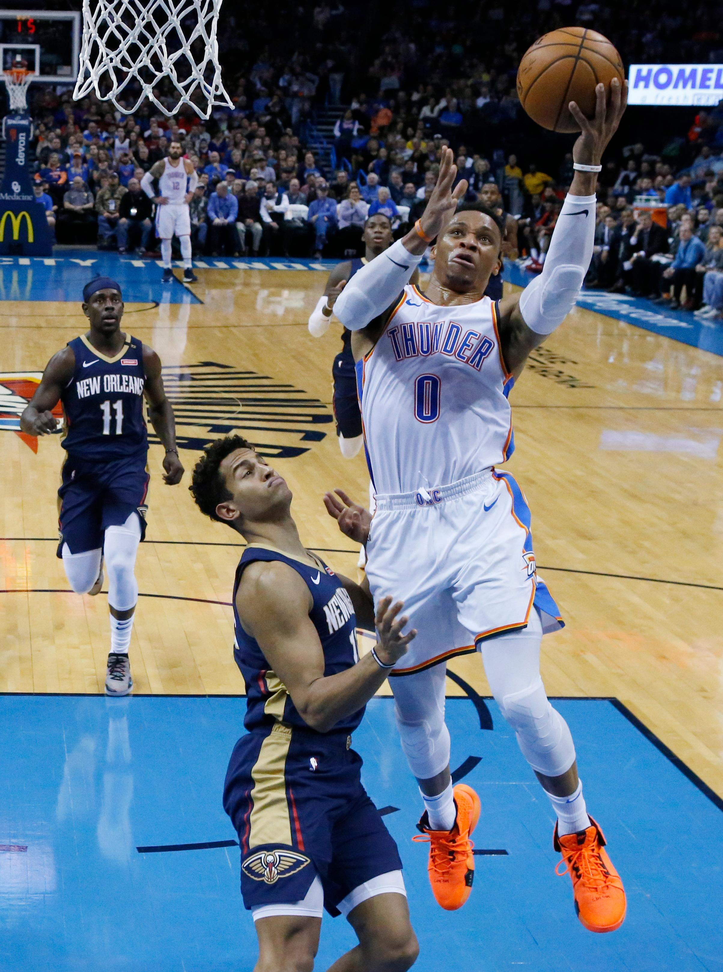 Oklahoma City Thunder guard Russell Westbrook (0) goes up for a shot in front of New Orleans Pelicans guard Frank Jackson during the first half of an NBA basketball game in Oklahoma City, Thursday, Jan. 24, 2019. (AP Photo/Sue Ogrocki)