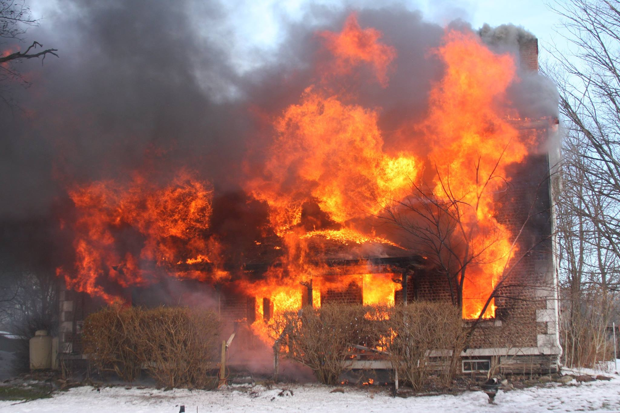A cobblestone house in Junius, Seneca County, was destroyed in a fire Wednesday afternoon. (Photo: Waterloo FD)